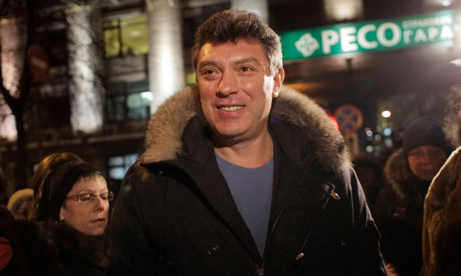 Russian opposition leader Boris Nemtsov smiles during a rally in central Moscow, Russia, Monday, Jan. 31, 2011. Opposition groups have been calling rallies on the 31st day of each month to honor the 31st article of the Russian Constitution, which guarantees the right of assembly. Most of the rallies have been banned or dispersed by police as unsanctioned. (AP Photo/Alexander Zemlianichenko)
